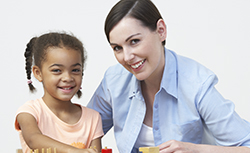 Early childhood educator instructing a child